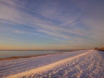 在雪的日出 库存图片