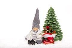 在雪的木偶 免版税库存图片