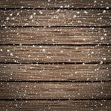 在雪的木纹理背景 免版税库存图片