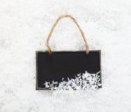 在雪的板岩黑板 免版税图库摄影