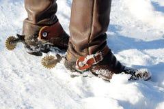 在雪的牛仔靴 免版税库存照片