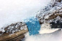 在雪的笤帚 图库摄影