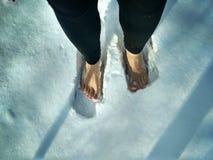 在雪的脚 免版税库存图片