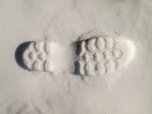 在雪的起动脚步 库存图片