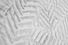在雪的轮胎标记 库存图片