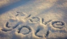 在雪的题字我爱你 免版税库存图片