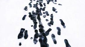 在雪的Shoeprints 库存照片
