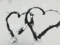 在雪绘的两心脏 库存照片
