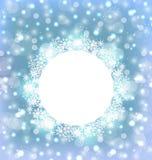 在雪花做的圣诞节框架在典雅的发光的背景 免版税库存照片