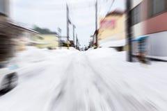 在雪路的抽象行动迷离快速的驱动 免版税库存图片