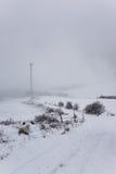 在雪风暴的无线发射基地 免版税库存图片