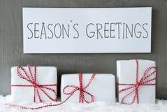 在雪,文本的白色礼物晒干问候 库存照片