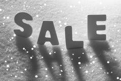 在雪,雪花的白色词销售 库存照片