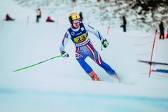 在雪以后结束浪花的女孩滑雪者在俄国杯期间的在高山滑雪 免版税库存照片