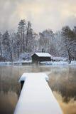 在雪暴雨水的木板走道 库存照片
