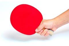 在震动手样式的举行的正手击球乒乓球的 免版税库存照片