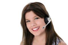 在青少年的白色的美丽的女孩耳机 免版税库存图片