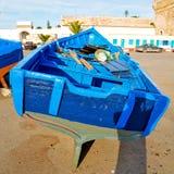 在非洲摩洛哥老港口木头和抽象饼的小船 库存图片