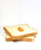 在面包的蜂蜜 库存照片