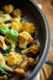 在面团烘烤的花椰菜 库存图片