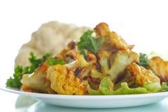 在面团烘烤的花椰菜 免版税图库摄影