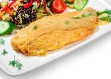 在面团的油煎的鱼与菜 库存照片