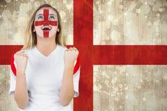 在面孔油漆欢呼的激动的爱好者英国 免版税库存照片