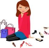 在鞋店的俏丽的女孩购物 库存图片