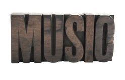 在音乐木头上写字 免版税库存照片