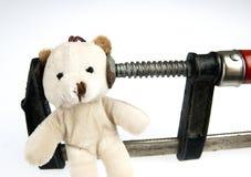 在顶头玩具熊玩具的钳位 库存照片