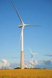 在领域的两台风电发电器在夏天晚上 爱沙尼亚 库存照片