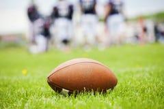 在领域的橄榄球球 免版税图库摄影