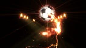 在领域的足球在颜色照明设备下 体育队概念 o ?? ?? 聚光灯在晚上 股票录像