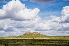 在领域的高原与Cloudscape 免版税库存图片