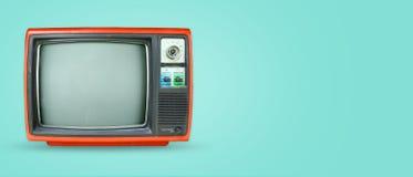 在颜色背景的减速火箭的电视 库存照片