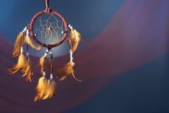 在颜色背景的Dreamcatcher 免版税库存图片