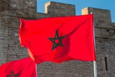 在风的摩洛哥旗子 免版税库存图片