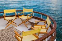 在风船甲板的黄色椅子 免版税库存图片