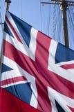 在风船的英国旗子 免版税库存照片