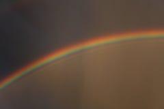 在风雨如磐的天空的彩虹 库存照片