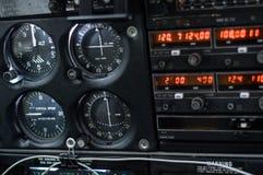 在飞机客舱的仪表板 免版税图库摄影