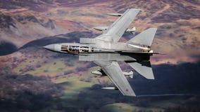 在飞行中军用喷气机 图库摄影