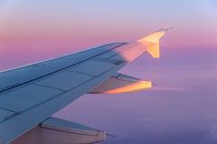 在飞行中日落 免版税库存照片