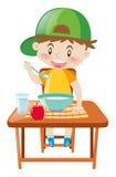 在餐桌上吃早餐的小男孩 向量例证