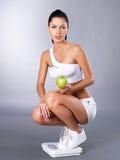 在饮食以后的健康妇女 库存图片