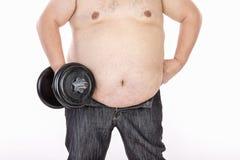 在饮食和健身前的大腹部人 免版税图库摄影