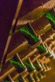 在香槟瓶的沉积 图库摄影