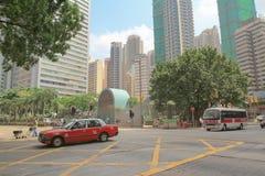 在香港街道的红色出租汽车  库存图片