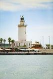 在马拉加的口岸的灯塔 安大路西亚 库存图片