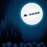 在驯鹿雪橇的圣诞老人乘驾 库存图片